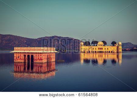 Vintage retro hipster style travel image of Rajasthan landmark - Jal Mahal (Water Palace) on Man Sagar Lake on sunset.  Jaipur, Rajasthan, India