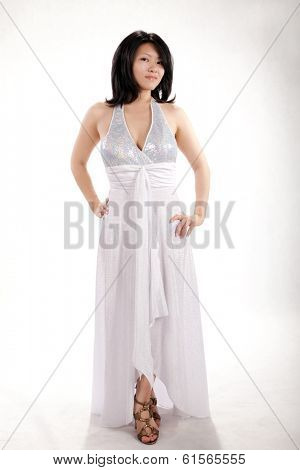 A girl in a dress on a white background