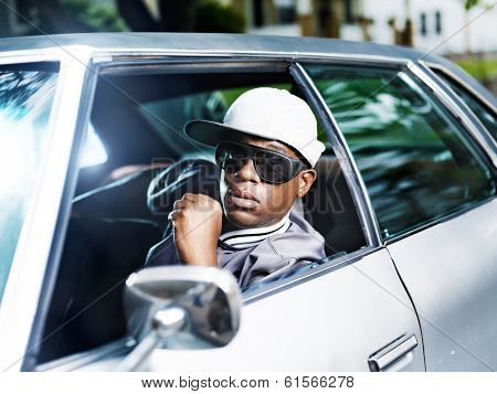 cool african man in old car