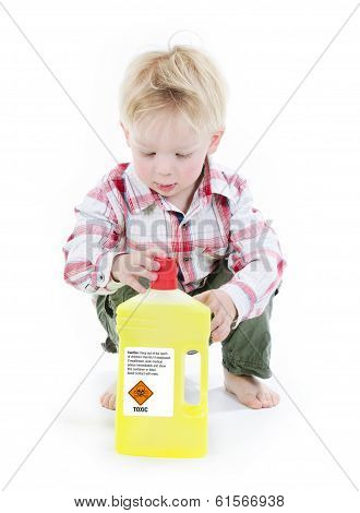 Child playing with cleaners