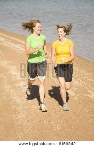 Happy Women Running On Beach