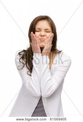 Half-length portrait of funny woman with closed eyes touching her face, isolated on white