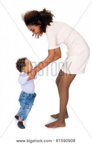 African mother teaching her 11 month old son to walk