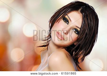 Portrait Of A Beautiful Woman With Creative Hairstyle.
