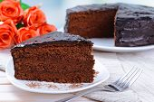 stock photo of tort  - Delicious chocolate cake on plate on table close - JPG