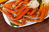 stock photo of cooked crab  - Snow Crab legs with fresh lemon slices - JPG