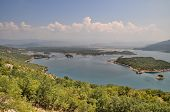 stock photo of negro  - Blue Lake and an island in Monte Negro - JPG