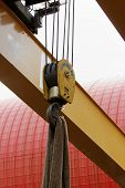 stock photo of crane hook  - industrial crane hook with wire rope holding the load - JPG