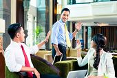 stock photo of say goodbye  - Businesspeople saying goodbye in a hotel - JPG
