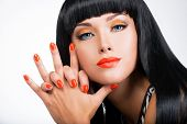 stock photo of long nails  - portrait of a beautiful woman with red nails and glamour makeup and long black hairs  - JPG