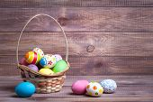 image of nest-egg  - easter eggs on wooden background - JPG