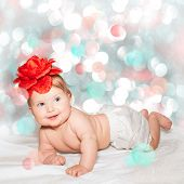 Little baby girl with red flower hat