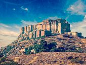 Vintage retro hipster style travel image of Mehrangarh Fort, Jodhpur, Rajasthan, India with grunge t