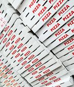 picture of take out pizza  - Piled pizza boxes in an italian fast food restaurant - JPG