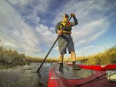 picture of collins  - mature male paddler enjoying workout on an inflatable stand up paddleboard  - JPG