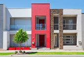 stock photo of suburban city  - typical facade of a modern town suburban house at noon - JPG