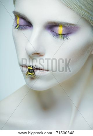 Bumblebee: Model With Creative Make-up And Bug On Her Lips