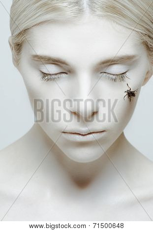 Hibernation And Sleep: Girl With Closed Eyes And Insect