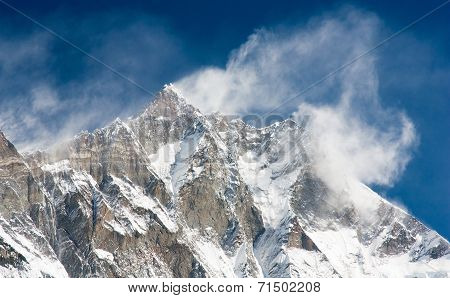 Top Of Lhotse And Nuptse With Windstorm And Snow Clouds On The Top