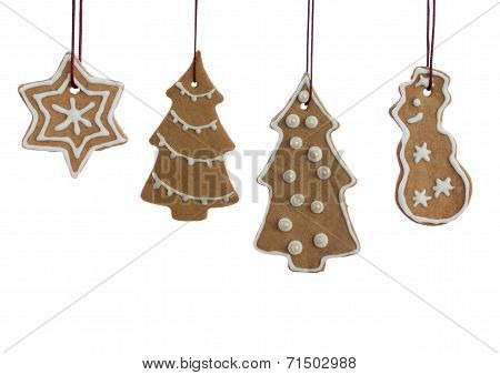 Hanging Decorated Ginger Bread Christmas Cookies On White