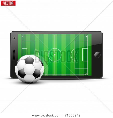 Mobile phone with soccer ball and field on the screen.
