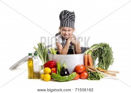 girl sitting in a huge cooking pot