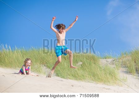 Kids Playing In Sand Dunes