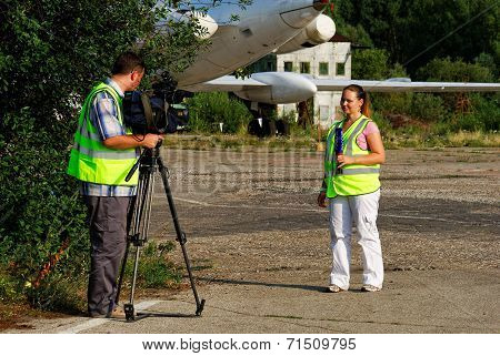 NIZHNY NOVGOROD. RUSSIA. JULY 31, 2014. STRIGINO AIRPORT.Journalists write down the reporting.