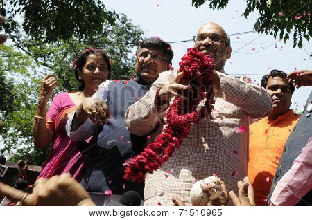 Amit Shah holding a garland.