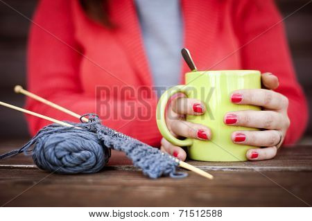 Winter girl knitting