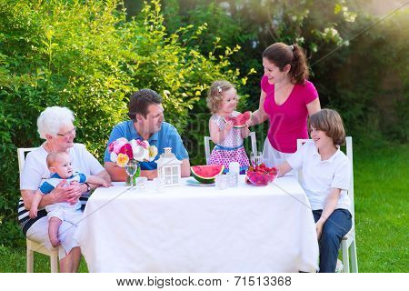 Family Having Lunch In The Garden
