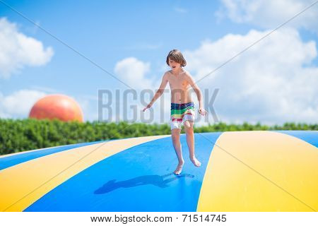 Happy Child Jumping On A Trampoline