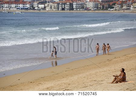 BAIONA, GALICIA, SPAIN - AUGUST 30: People at the beach, on August 30, 2014 in Baiona, Galicia, Spain.