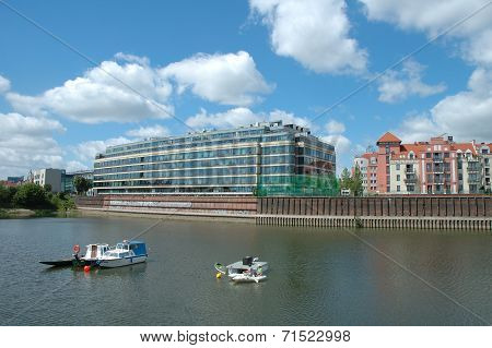 Boats And Modern Building At Warta River In Poznan, Poland