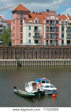 Boats And Building At Warta River In Poznan, Poland
