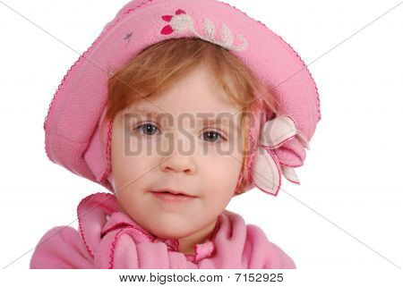 little girl with pink hat and scarf portrait