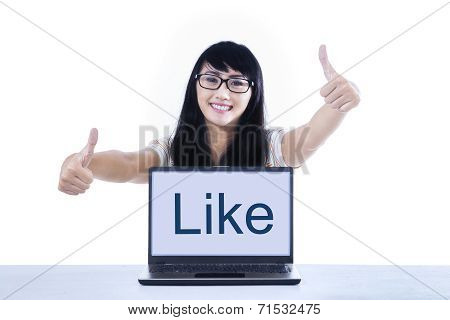 College Student Giving Thumbs Up With Like On Laptop