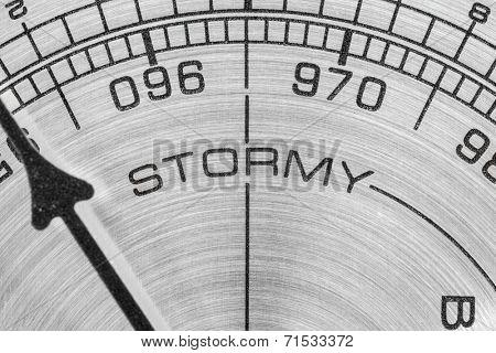 Stormy barometer gauge macro detail.