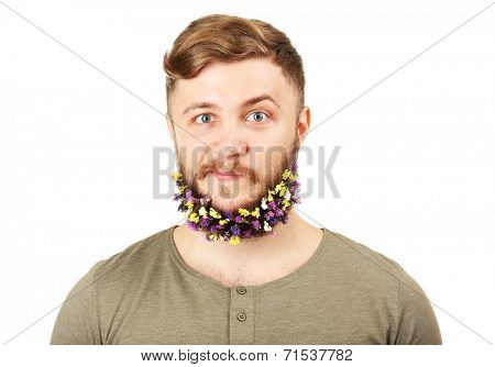 Portrait of handsome man with beard of flowers isolated on white