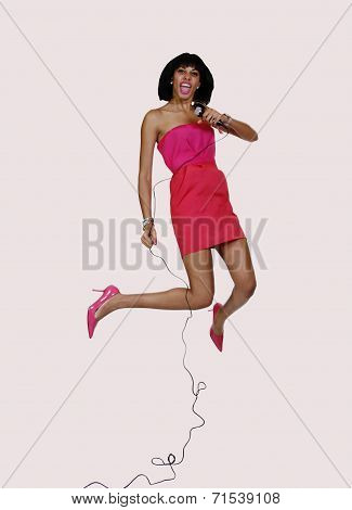 Young Black Woman Dress Jumping With Mic