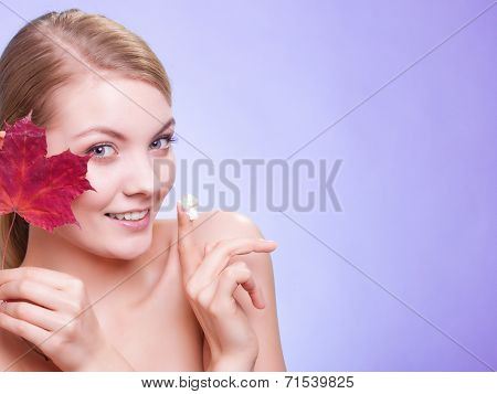 Face Of Young Woman Girl With Red Maple Leaf.