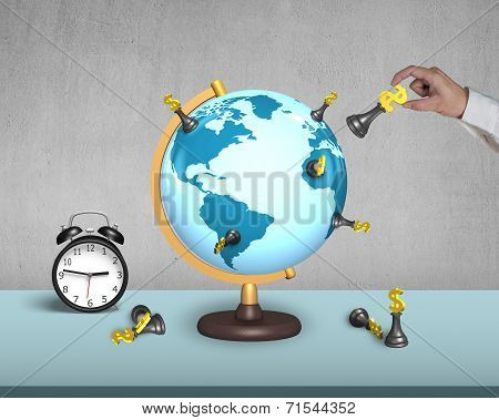 Hand Holding Dollar Chess On Globe With Alarm Clock