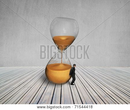 Man Keeping The Tilt Hourglass