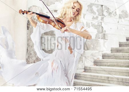 Beautiful blond hair woman with violin