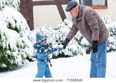 Grandfather And Toddler Boy  On Winter Day