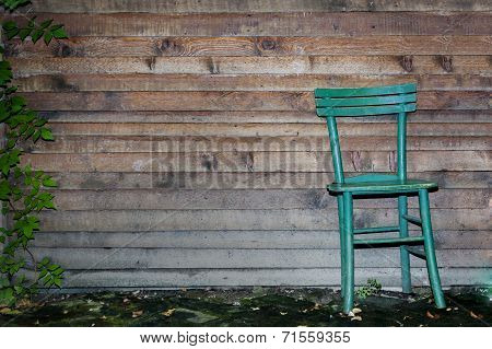 Wooden Chair Against Wood Wall