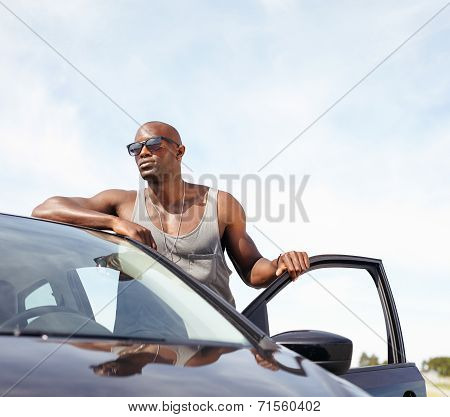 Smart Young Man With A Car