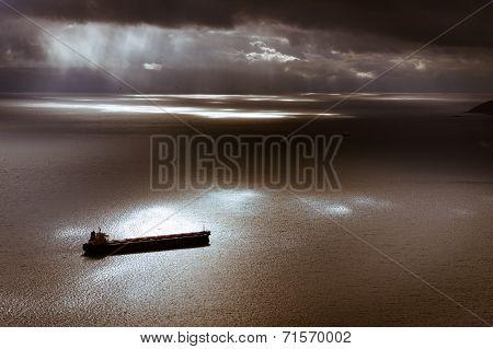 Dark Moody Sky And Mediterranean Sea With Ship Leaving Gibraltar.