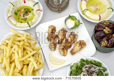 Arabic food presented on a table in a restaurant,