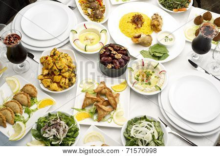 Arabic food of dates, hommos, cheese, labneh and fattoush served in Ramadan